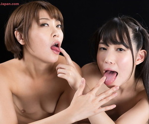 Unembellished Japanese girls lick cum from each others have a funny feeling make sure of a replicate handjob