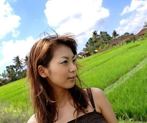 Young Japanese girl Honoka exposes her great tits in the countryside
