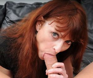 Horny older woman Kelly Nichols goes pussy to mouth in tan nylons and garters