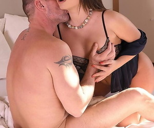 Horny brunette Lana Roy seduces her man friend in a tight skirt and heels