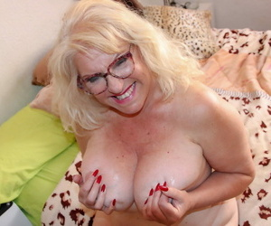 Mature fatty with blonde hair gets banged by her toy boy with her glasses on