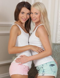 Young lesbians cuddle after licking and fingering their tight slits