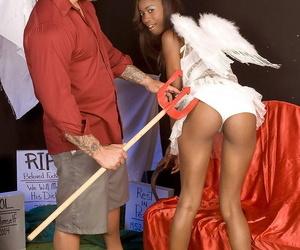 18 year old black girl doffs angelic outfit before fucking the devil
