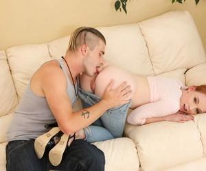 Natural redhead Athena Rayne takes a cumshot around brashness after sexual congress at bottom a sofa
