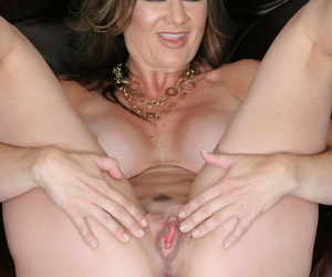 Mature pornstar Raquel Devine stands naked before sucking & fucking a big dick