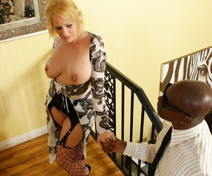 Mature woman Sunny Day fucks a big black dick in slutty hosiery