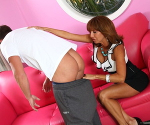Mature cougar Tara Holiday fucked after giving young stud a lusty rimjob