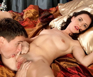 Mature brunette Danielle Reage lets a young stud worship and fuck her holes