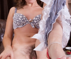 Bored housewife with a hairy beaver spreads her legs on the coffee table