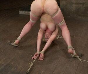 Chunky titted redhead Dee Williams endures mega pain in bandage subjugation scene