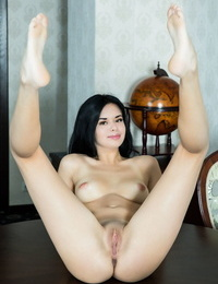 Young Latina Carmen Summer lifts her dress for a sexy naked upskirt