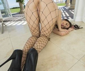Sexy Mandy Muse flaunts her sexy ass & tiny tits clad in fishnet outdoors