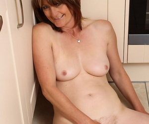 Mature housewife loses jeans and undershorts everywhere masturbate atop the kitchen nonplus