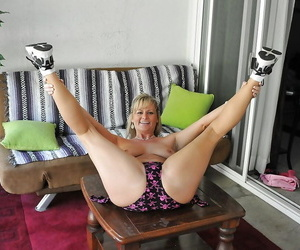 Playful blonde MILF Becca Blossoms undressing and spreading her legs
