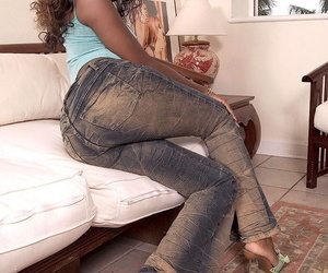 Hot ass Sapphira slips off tight jeans and flaunts her sexy oiled ebony booty