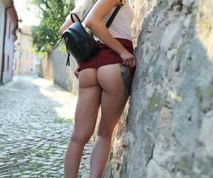 Charming blonde teen Anna Di hikes her skirt up with no panties on outdoors