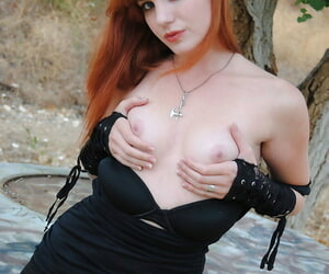 Redhead amateur Nicci Gont exposes small tits and bares ass in the outdoors