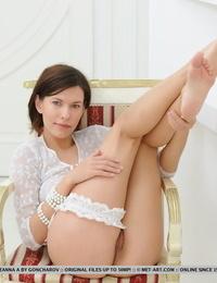 Solo model Suzanna A wears a garter around a bare leg wearing a short blouse