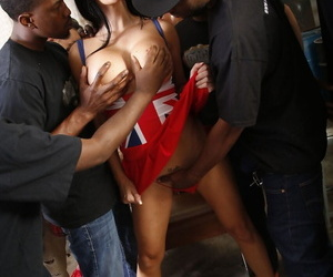 Dark haired chick in slutty UK garb gets gangbanged by black men