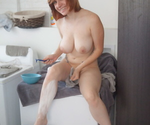 Big titted redhead Chelsea Bell shows her trimmed pussy after shaving her legs