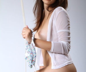 Gorgeous young doll Gea strips out of her panties to reveal her pussy