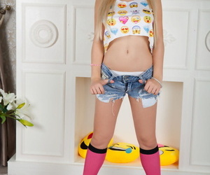 Young looking blonde Kylie wears her hair in pigtails greatest extent disrobing down socks