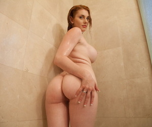 Cute girl Lilith Lust lets out her fake breasts and teases in the shower