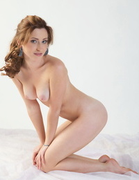 Solo girl Janelle slips out off her panties for delightful nude poses on bed