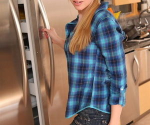 Amateur beauty Taylor True strips naked in the kitchen with hair in ponytail