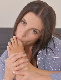 Charming Jasmine Jazz licks her delicious toes and fingers her cunt in bed