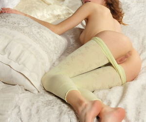 Skinny girl Debora A peels off her tight pants to put her naked ass in the air