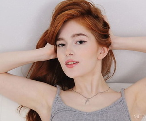 Red hot redhead Jia Lissa doffs cotton panties for closeup pussy fingering