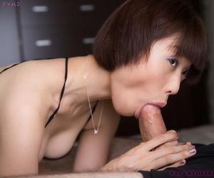 Japanese chick Mizuki sucks the cum from a cock during a blowjob