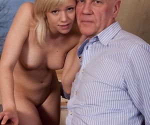 Young looking blonde girl has her toes licked after oral sex with an old man