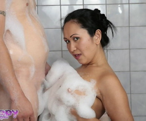 Asian masseuse Kitty Langdon pleasures a clients cock after a soapy massage