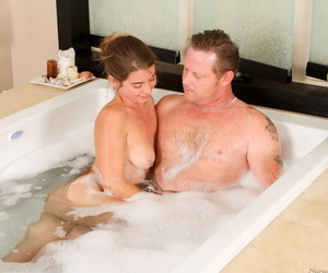 Sexy masseuse Bunny Freedom gives a man a bath during a full service massage