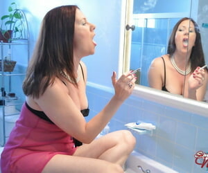 Brunette solo girl Mina removes her lingerie while smoking in the bathroom