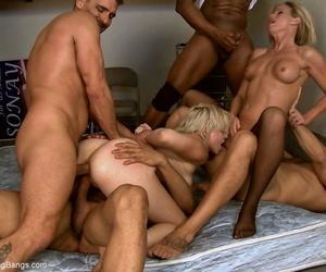 Female sex slaves endure double anal penetrations during a gangbang