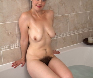 Curvy brunette girl Melissa shows her hairy cunt in the bathtub