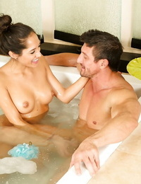 Masseuse Chloe Amour with nice tits tongues cock in bath & gives oiled handjob