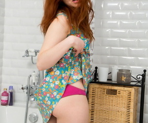 Natural redhead Arial appeases her sex-mad teen pussy everywhere the bathtub