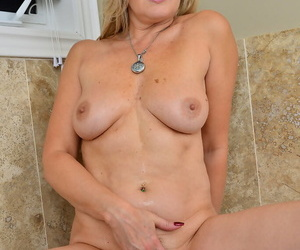 Blonde hot mature Velvet Skye bares perfect big tits & spreads in the bathtub