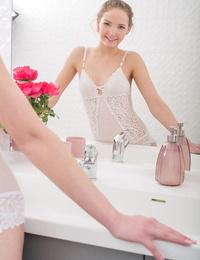 Adorable young Faina Bona strips white sheer lingerie to show closeup pussy