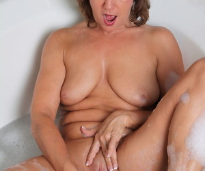 Mature wholesale pleasures the brush sex-crazed pussy while taking a sputter bath