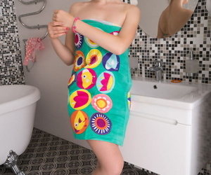 Adorable teen Dazy takes off her bath towel to model naked before a bath