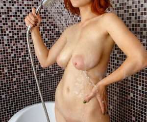Young redhead Eva Blade bares great tits before sticking a toothbrush in twat