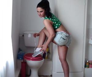 Dark haired amateur Nicola Kiss gets fucked on the dirty bathroom floor