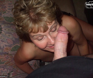 Older woman with saggy boobs pleasures a cock with feet and mouth POV style