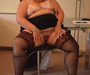 Mature blonde BBW Lexie Cummings strips to her stockings and masturbates