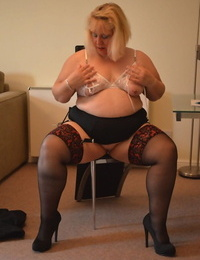Full-grown bazaar BBW Lexie Cummings strips nigh her stockings and masturbates